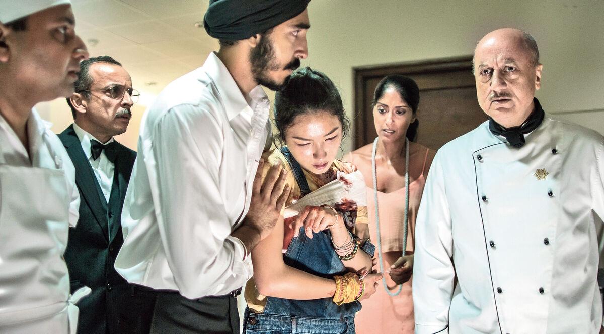 Dev Patel and Anupam Kher - Hotel Mumbai