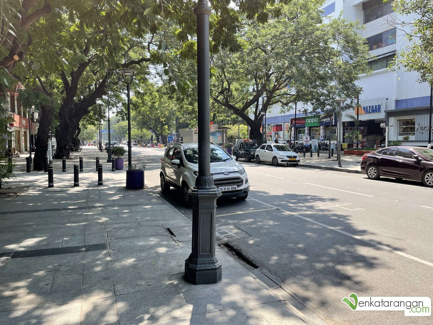 At 10 AM, the footpath and the curbside parking are mostly empty